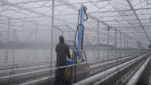 Pipe rail greenhouse roof cleaner